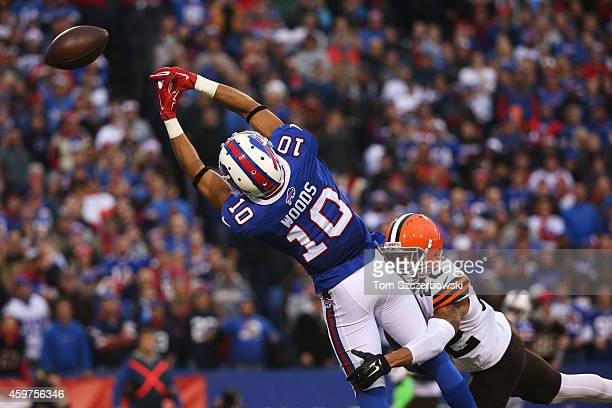 Robert Woods of the Buffalo Bills can't make the catch as Buster Skrine of the Cleveland Browns defends during the second half at Ralph Wilson...