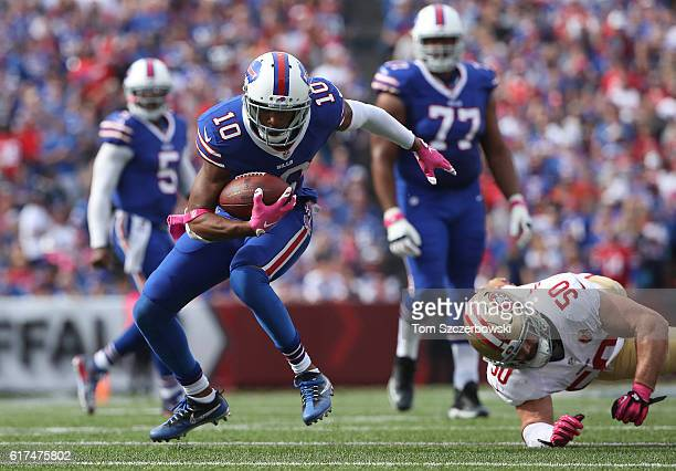 Robert Woods of the Buffalo Bills carries the ball during NFL game action as Nick Bellore of the San Francisco 49ers attempts a tackle at New Era...