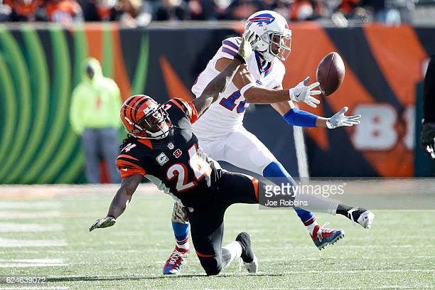 Robert Woods of the Buffalo Bills catches the ball after it was tipped by Adam Jones of the Cincinnati Bengals during the first quarter at Paul Brown...