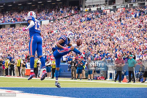 Robert Woods of the Buffalo Bills celebrates a touchdown reception with Justin Hunter during the second half against the San Francisco 49ers on...