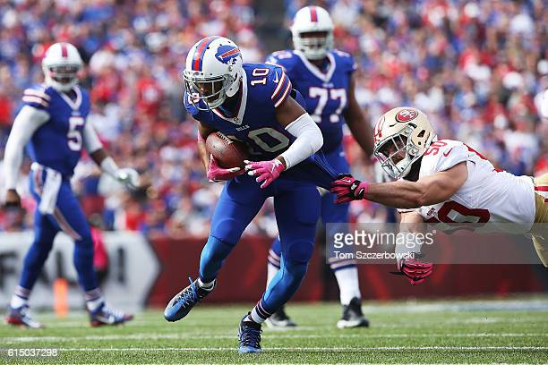 Robert Woods of the Buffalo Bills is grabbed by Nick Bellore of the San Francisco 49ers during the first half at New Era Field on October 16, 2016 in...