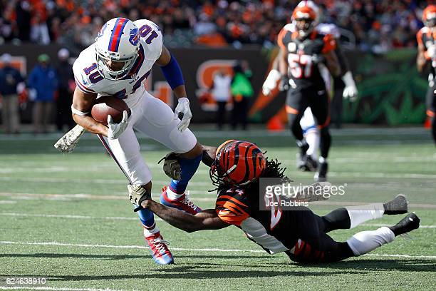 Robert Woods of the Buffalo Bills is tackled by Adam Jones of the Cincinnati Bengals during the first quarter at Paul Brown Stadium on November 20...