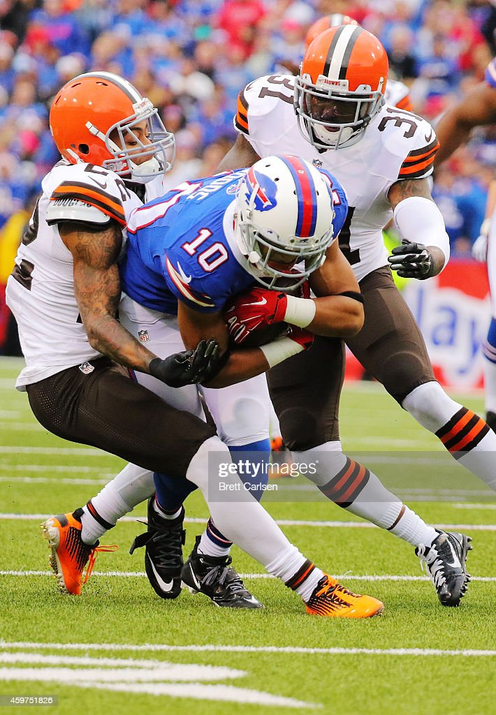 Robert Woods #10 of the Buffalo Bills is tackled by Buster Skrine #22 of the Cleveland Browns and Donte Whitner #31 of the Cleveland Browns during the first half at Ralph Wilson Stadium on November 30, 2014 in Orchard Park, New York.