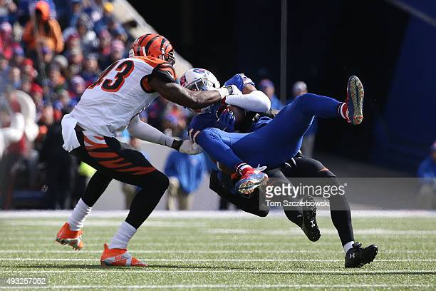 Robert Woods of the Buffalo Bills makes a catch as George Iloka of the Cincinnati Bengals defends during the first half at Ralph Wilson Stadium on...