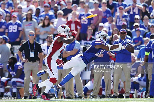Robert Woods of the Buffalo Bills makes a catch past Patrick Peterson of the Arizona Cardinals during the first half at New Era Field on September 25...