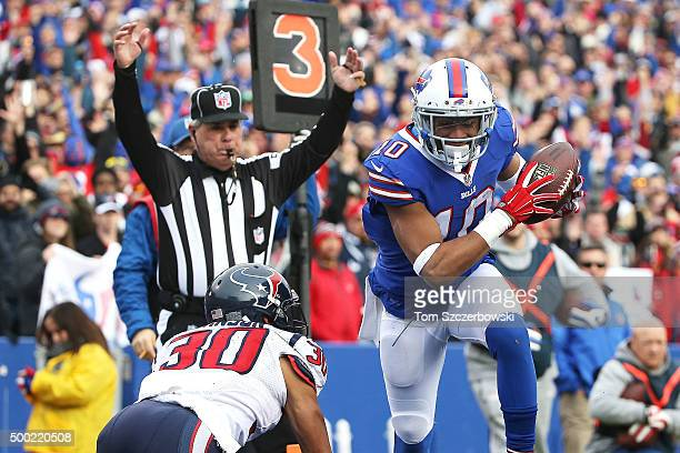 Robert Woods of the Buffalo Bills makes a touchdown reception past Kevin Johnson of the Houston Texans during the first half at Ralph Wilson Stadium...