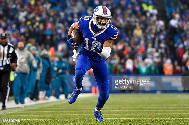 Robert Woods of the Buffalo Bills runs with the ball against the Miami Dolphins during the fourth quarter at New Era Field on December 24 2016 in...