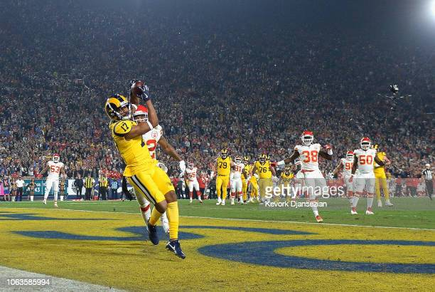 Robert Woods of the Los Angeles Rams catches a pass from quarterback Jared Goff to score a touchdown in the first quarter of the game against the...