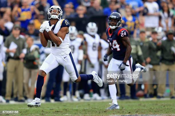 Robert Woods of the Los Angeles Rams catches a touchdown pass for ninety four yards as Johnathan Joseph of the Houston Texans defends during the...