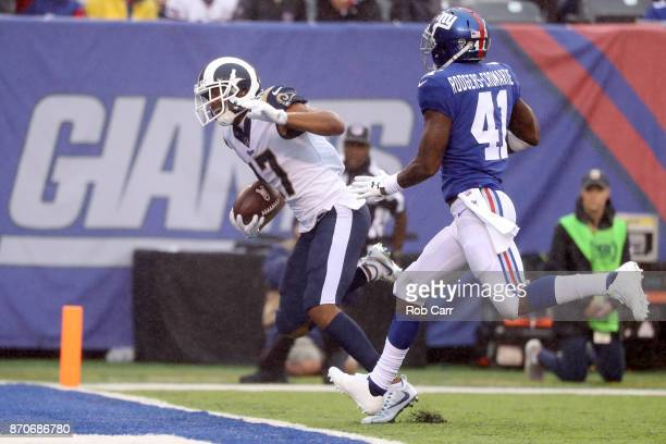 Robert Woods of the Los Angeles Rams catches a touchdown pass in front of Dominique RodgersCromartie of the New York Giants at MetLife Stadium on...