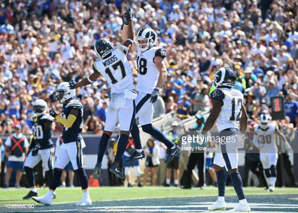 Robert Woods of the Los Angeles Rams celebrates his touchdown catch with teammate Cooper Kupp during the first quarter of the game against the Los...