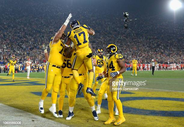 Robert Woods of the Los Angeles Rams celebrates his touchdown catch with teammates during the first quarter of the game against the Kansas City...