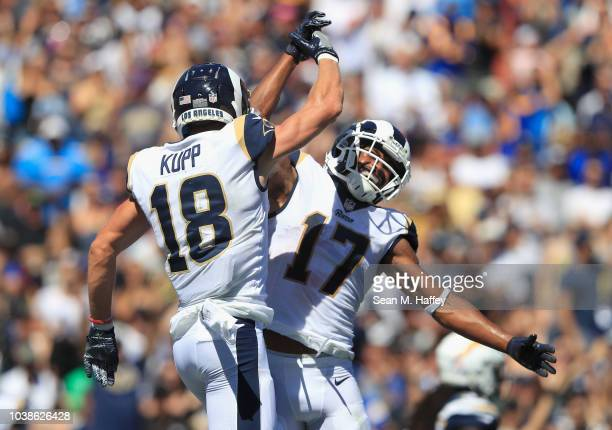 Robert Woods of the Los Angeles Rams celebrates his touchdown with teammate Cooper Kupp during the first quarter of the game against the Los Angeles...