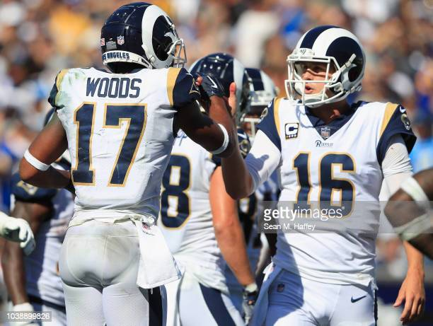 Robert Woods of the Los Angeles Rams celebrates his touchdown with quarterback Jared Goff during the third quarter of the game against the Los...