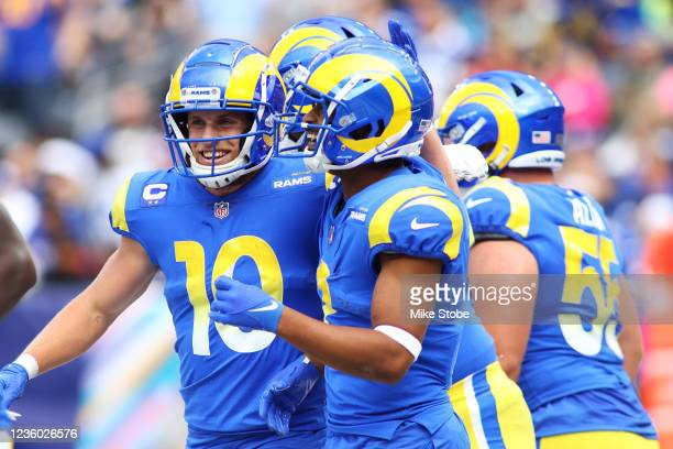 Robert Woods of the Los Angeles Rams celebrates his touchdown with Cooper Kupp against the New York Giants at MetLife Stadium on October 17, 2021 in...