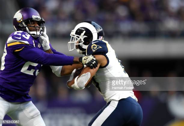 Robert Woods of the Los Angeles Rams collides with defender Terence Newman of the Minnesota Vikings while carrying the ball in the fourth quarter of...