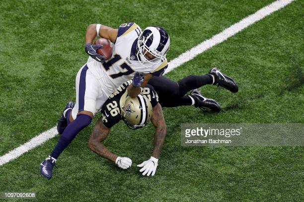 85f1a56d1 Robert Woods of the Los Angeles Rams is tackled by PJ Williams of the New  Orleans