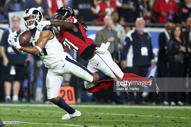 Robert Woods of the Los Angeles Rams makes a catch in front of Desmond Trufant of the Atlanta Falcons during the NFC Wild Card Playoff Game at the...