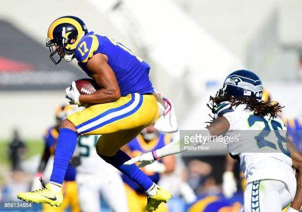 Robert Woods of the Los Angeles Rams makes a catch over the middle in front of Shaquill Griffin of the Seattle Seahawks during the fourth quarter in...