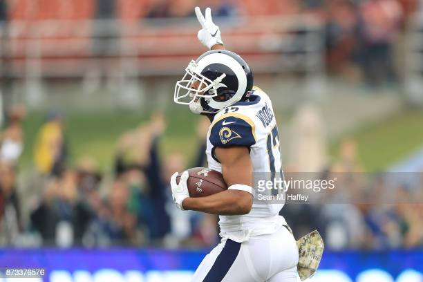Robert Woods of the Los Angeles Rams reacts as he runs to the end zone to score a touchdown during the game against the Houston Texans at the Los...