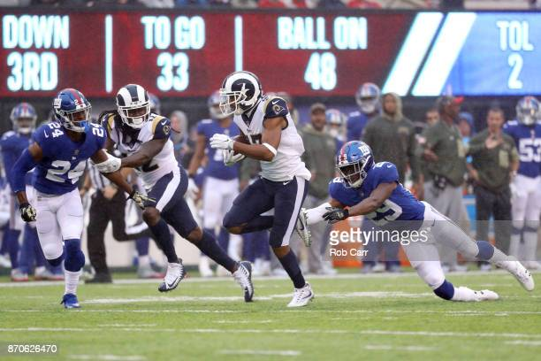 Robert Woods of the Los Angeles Rams rushes for a touchdown after catching a pass in front of Nat Berhe of the New York Giants in the first half at...