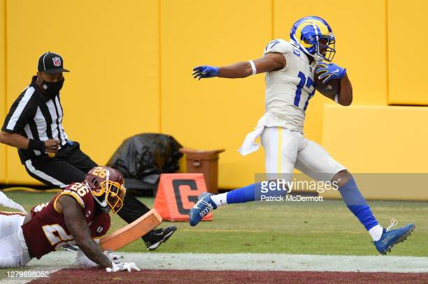 Robert Woods of the Los Angeles Rams scores a touchdown against Landon Collins of the Washington Football Team in the second quarter at FedExField on...