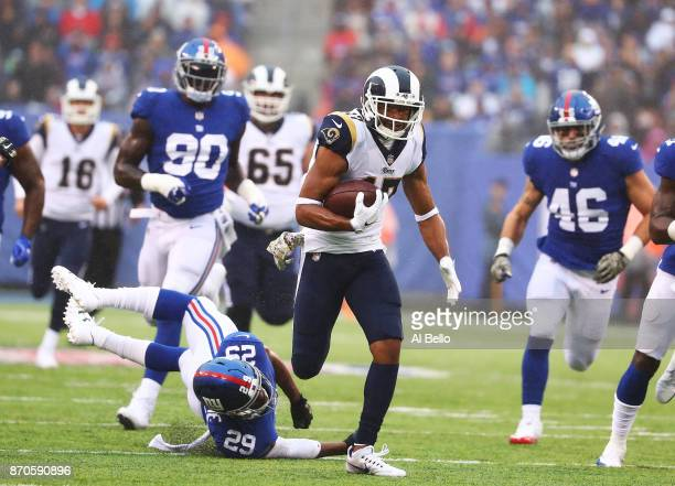 Robert Woods of the Los Angeles Rams scores a touchdown as Nat Berhe of the New York Giants misses the tackle in the second quarter during their game...