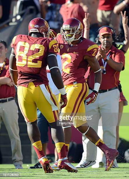 Robert Woods of the USC Trojans celebrates his touchdown with Randall Telfer during the first quarter against the Hawaii Warriors at Los Angeles...
