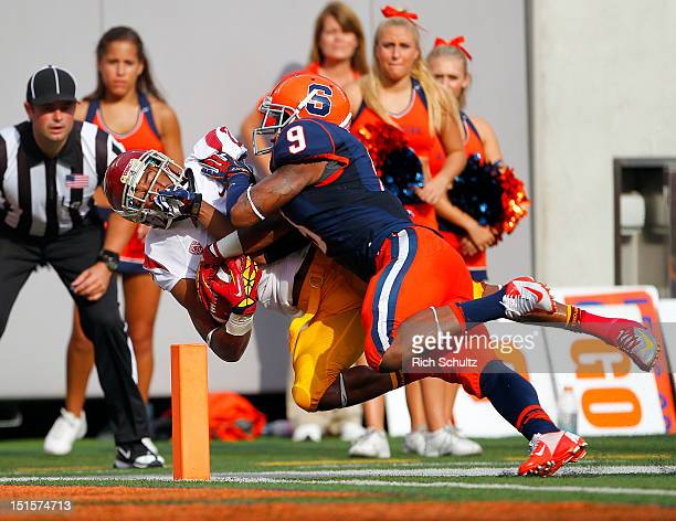 Robert Woods of the USC Trojans is tackled in the end zone for a touchdown by Ri'Shard Anderson of the Syracuse Orange in the first half during a...