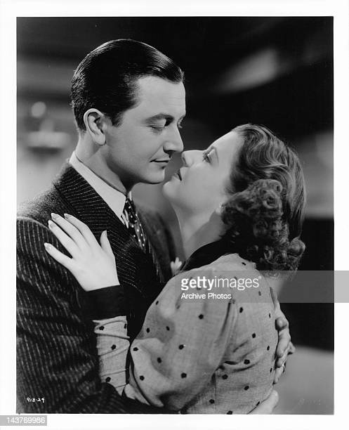 Robert Young about to kiss Betty Furness in a scene from the film 'The Three Wise Guys', 1936.