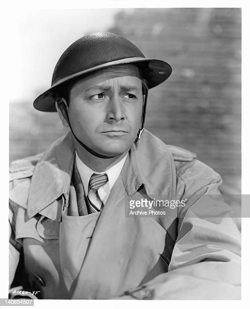 Robert Young wearing a pith helmet in a scene from the film 'Journey For Margaret' 1942