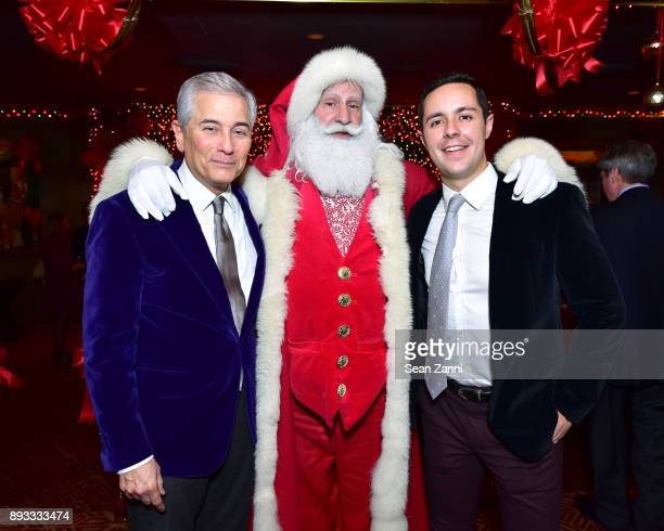 Robert Zimmerman Santa Claus and Pablo Cerrilla attend A Christmas Cheer Holiday Party 2017 Hosted by George Farias and Anne and Jay McInerney at The...