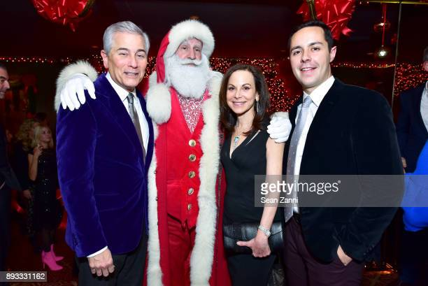 Robert Zimmerman Santa Claus Bettina Zilkha and Pablo Cerrilla attend A Christmas Cheer Holiday Party 2017 Hosted by George Farias and Anne and Jay...