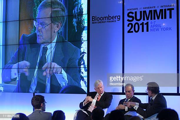 Robert Zoellick president of The World Bank Group right speaks while Dave Miller former mayor of Toronto left and Michael Bloomberg mayor of New York...