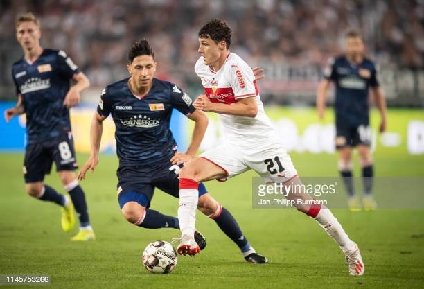 Robert Zulj of 1 FC Union Berlin and Benjamin Pavard of VfB Stuttgart during the Bundesliga relegation/promotion playoff first leg between VfB...
