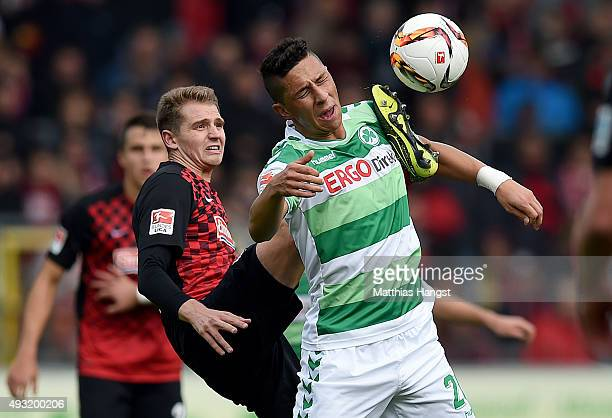 Robert Zulj of Fuerth is challenged by Immanuel Hoehn of Freiburg during the Second Bundesliga match between SC Freiburg and SpVgg Greuther Fuerth at...