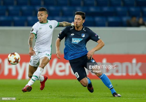Robert Zulj of Hoffenheim and Anicet Abel of Ludogorets battle for the ball during the UEFA Europa League group C match between 1899 Hoffenheim and...