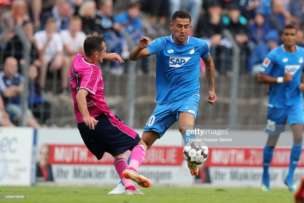 Robert Zulj of Hoffenheim competes for the ball against Josh Scowen of Queens Park Rangers during the pre-season friendly match between Queens Park Rangers and tSG 1899 Hoffenheim on July 21, 2018 in Eppingen, Germany.