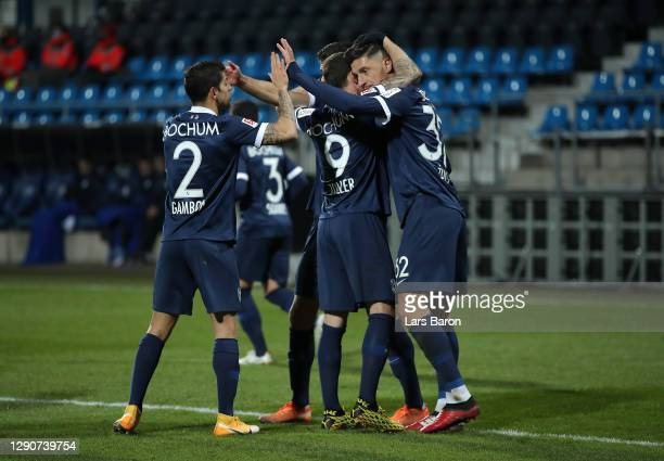 Robert Zulj of VfL Bochum celebrates with team mates Cristian Gamboa and Simon Zoller after scoring their sides second goal during the Second...