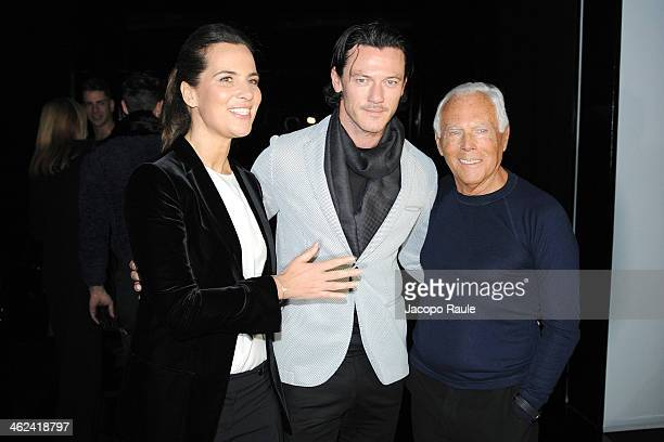 Roberta Armani Luke Evans and Giorgio Armani attend the Emporio Armani show as a part of Milan Fashion Week Menswear Autumn/Winter 2014 on January 13...