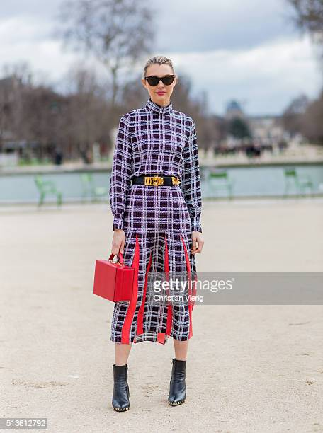 Roberta Benteler wearing a plaid dress a red Marc Cross bag and black Celine boots outside Carven during the Paris Fashion Week Womenswear...