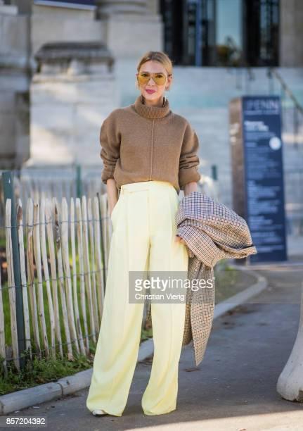 Roberta Benteler wearing brown turtleneck wide leg pants seen outside Chanel during Paris Fashion Week Spring/Summer 2018 on October 3 2017 in Paris...