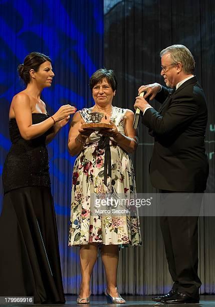Roberta Bortone Riccarelli collects the Premio Campiello won by her late husband Ugo Riccarelli for L'amore graffia il mondo from Geppi Cucciari and...