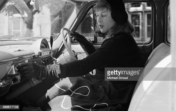 Roberta Cowell in her car, 1958. Cowell, a former racing driver and RAF pilot was the first person to undergo gender reassignment surgery in the UK.