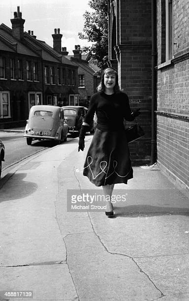 Roberta Cowell walking down a street, 1958. Cowell, a former racing driver and RAF pilot was the first person to undergo gender reassignment surgery...