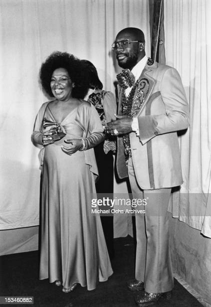 Roberta Flack winner of Album of the Year for 'Killing me Softly With His Song' and Isaac Hayes pose backstage at the 16th Annual Grammy Awards on...