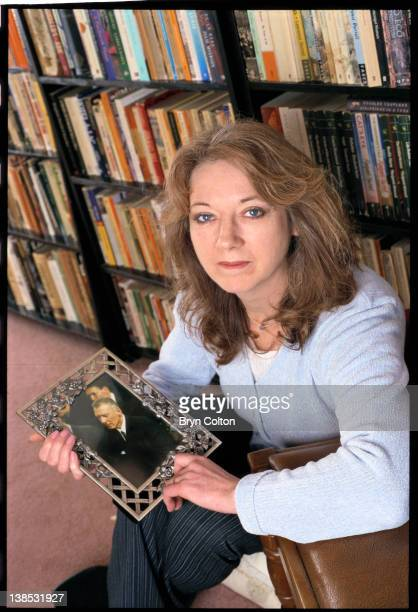 Roberta Kray the wife of east end gangster Reggie Kray holds a photograph of her husband while at her home in Watton UK on Friday January 7 2000...