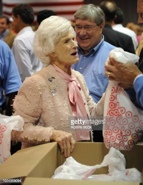 Roberta McCain mother of Republican presidential candidate Arizona Sen John McCain talks as she helps prepare comfort packages at the GOP Delegates...