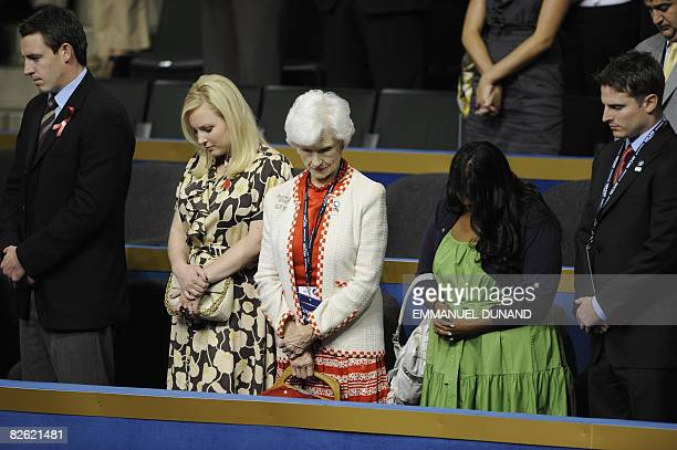 Roberta McCain the 96yearold mother of US Republican presidential candidate John McCain his daughters Meghan and Bridget listen to a prayer at the...