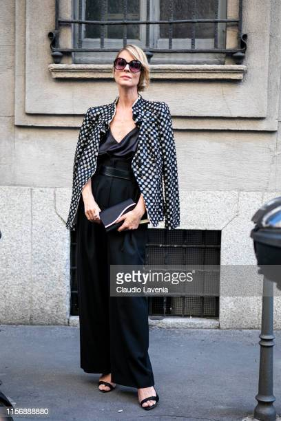 Roberta Ruiu wearing a black silky top black wide leg pants black sandals black purse and black and white decorated blazer is seen outside Giorgio...